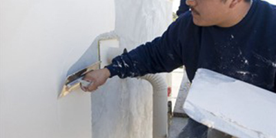 Smoothing out stucco wall