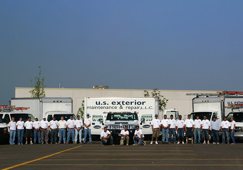 Group staff photo in front of work truck